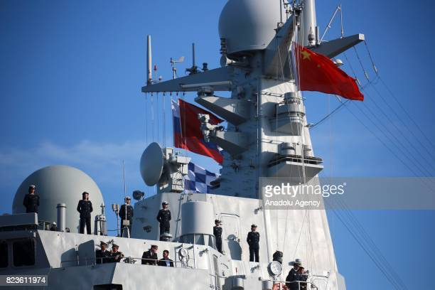 Sailors on board of China's missile destroyer Hefei arrives at St Petersburg to take part in a ship parade marking Russian Navy Day in St Petersburg...