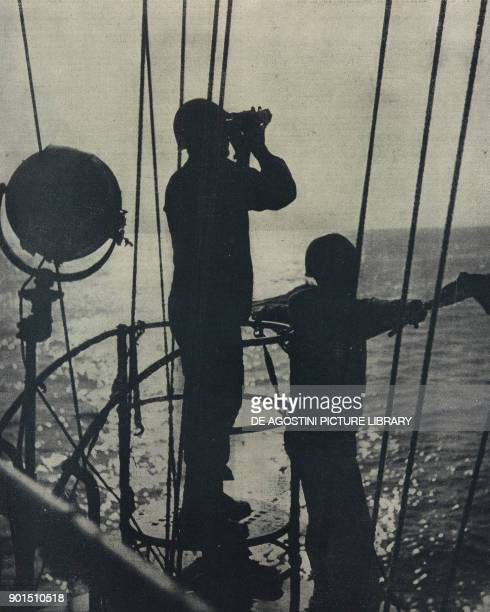 Sailors on lookout duty aboard a Italian navy ship World War II from L'Illustrazione Italiana Year LXX No 32 August 8 1943