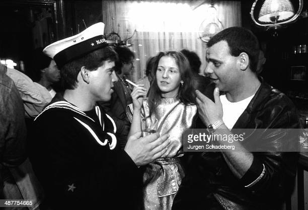 Sailors on shore leave in a bar near the harbour in Hamburg Germany early 1980s
