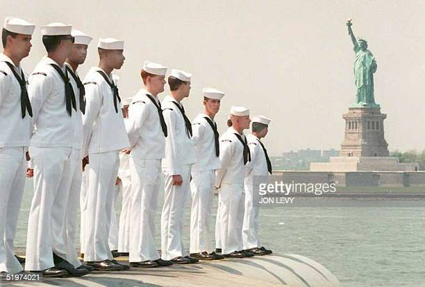Sailors on the Aircraft Carrier USS America man the rails as the ship steams past the Statue of Liberty at the start of the eighth annual Fleet Week...