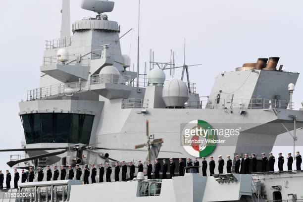 Sailors on the deck of the aircraft carrier HMS Queen Elizabeth as Veterans depart Portsmouth on MV Boudicca to Normandy retracing the voyage they...