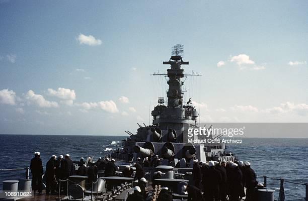 Sailors on the deck of the US Naval Battleship USS Iowa known as 'The Big Stick' in 1943 somewhere in the Atlantic Ocean.