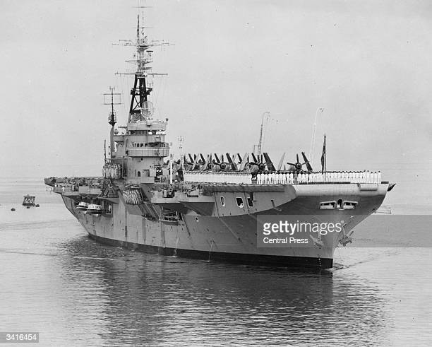 Sailors parading on board HMAS Vengeance, the new flagship of the Australian Navy, on arrival at Fremantle.