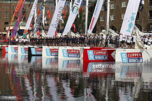 Sailors prepare their boats to depart from St Katharine Docks for the start of the 'Clipper 201314 Round the World Yacht Race' on September 1 2013 in...