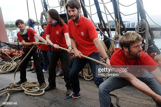 Sailors pull ropes on the boat Hermione on August 10 2015 in Brest western of France A replica of the French frigate that transported General...