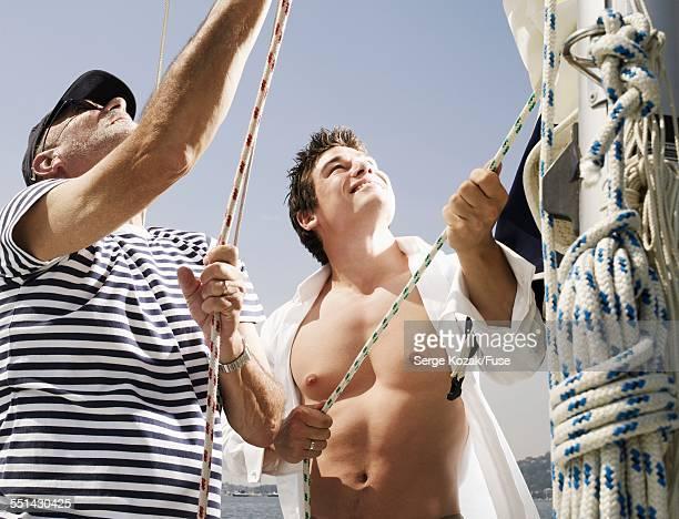 Sailors Pulling on Lines
