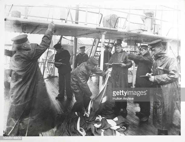 Sailors raising and lowering flags on the signal bridge of the Royal Navy cruiser 'HMS St George' circa 1900 The vessel was built in 1892 became a...