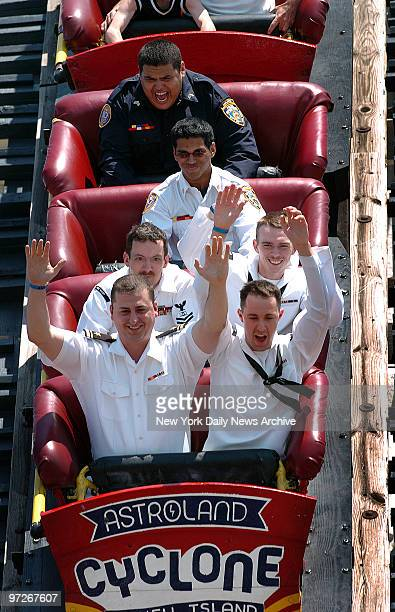 Sailors ride the Cyclone in Coney Island LTJG Kevin Ross and AT3 Brian Yancey CS2 Thomas Hicks and AOAN Joseph Bruner Sujit Nair with NYPD Explorers...