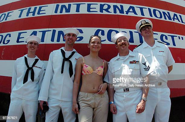 Sailors ride the Cyclone in Coney Island LTJG Kevin Ross and AT3 Brian Yancey CS2 Thomas Hicks and AOAN Joseph Bruner