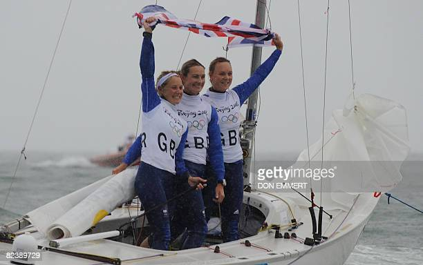 Sailors Sarah Ayton Sarah Webb and Pippa Wilson of Great Britain celebrate their gold medal win race in the Ygling class in the 2008 Beijing Olympic...
