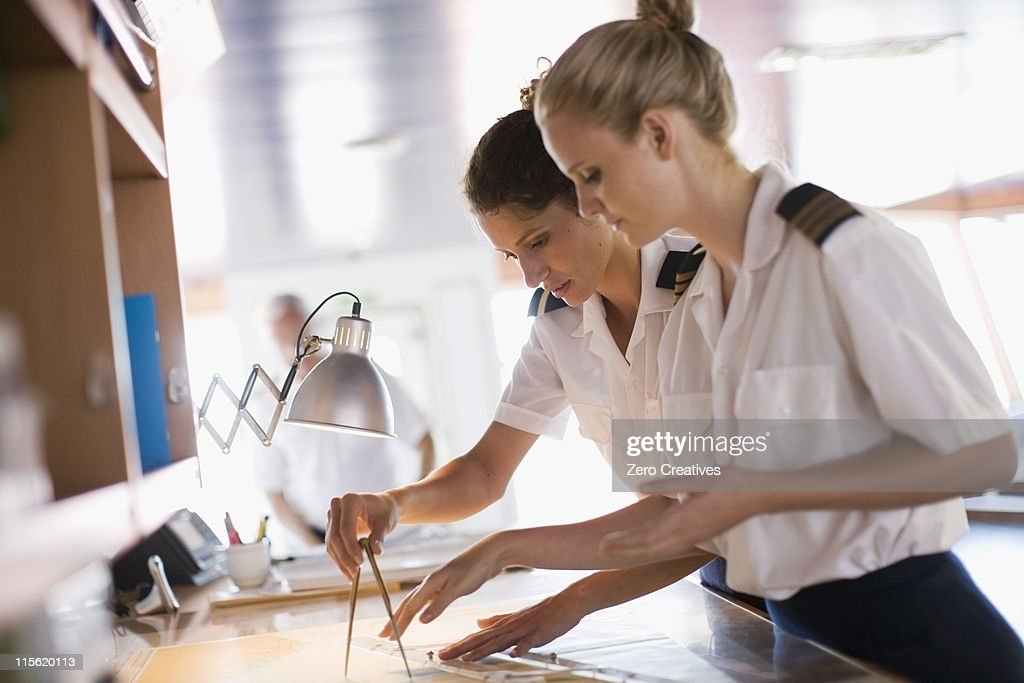 Sailors setting the compasses : Stock Photo