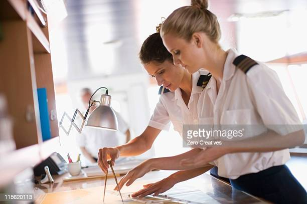 sailors setting the compasses - team captain stock pictures, royalty-free photos & images