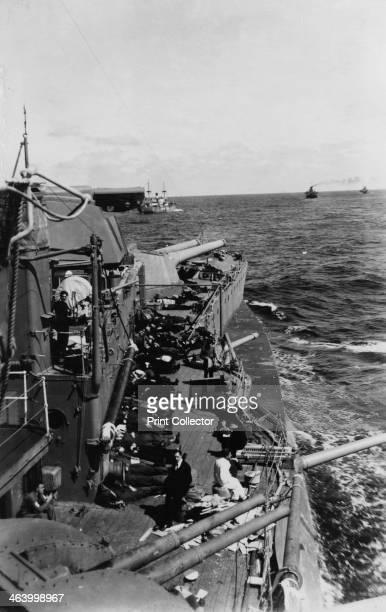 Sailors sleeping on the upper deck of the British battleship HMS 'Malaya', c1940-c1941. 'Malaya' was on Atlantic convoy duty at the time.