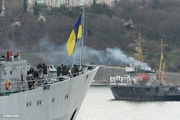 Sailors stand aboard the Ukrainian naval command ship Slavutych on March 6, 2014 in Sevastopol, Ukraine. Russian warships are standing nearby to...