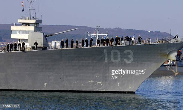 Sailors stand guard as the US Navy destroyer 'USS Truxtun' enters the Black Sea port of Varna in Bulgaria on March 13 2014 The USS Truxtun departed...