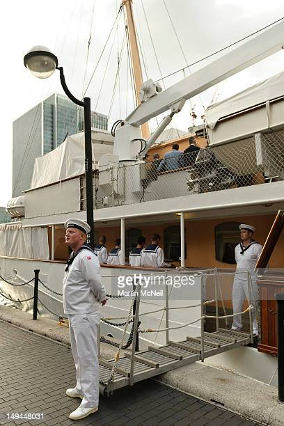 Sailors stand guard during a reception for businesses on the Royal Yacht Dannenbrog whilst it is moored at West India Docks at Canary Wharf on July...
