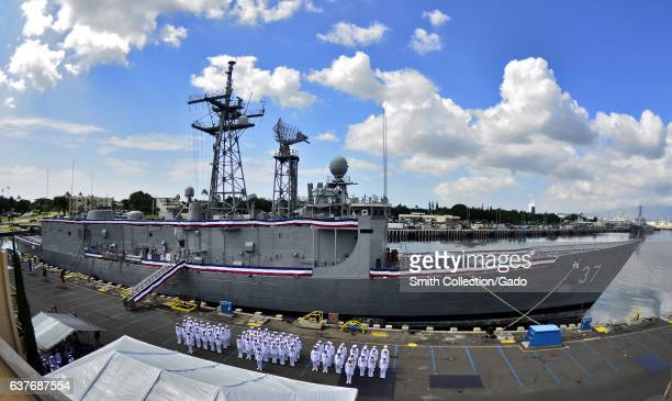 Sailors stand in formation in front of guidedmissile frigate USS Crommelin during its decommissioning ceremony on Joint Base Pearl HarborHickam...