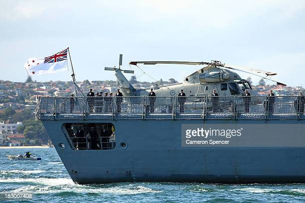 Sailors stand on Royal New Zealand Navy warship HMNZS Te Mana as it arrives in Sydney Harbour on October 4 2013 in Sydney Australia Over 50 ships...