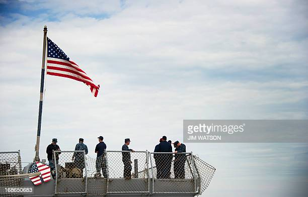 Sailors stand on the aft aboard the Arleigh Burkeclass guided missile destroyer USS Stout at Naval Station Norfolk in Norfolk Virginia May 8 during...