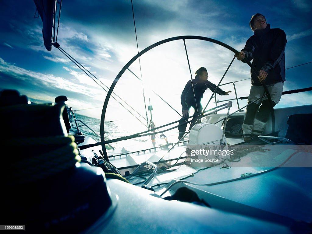 Sailors steering yacht : Stock Photo