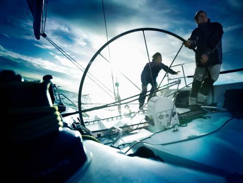 Sailors steering yacht - gettyimageskorea