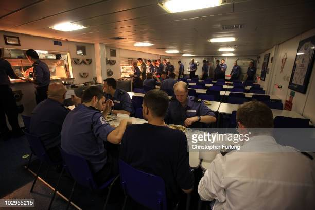 Sailors take their meals in the galley of HMS Ark Royal during Exercise Auriga on July 14 2010 at sea in Onslow Bay near North Carolina HMS Ark Royal...