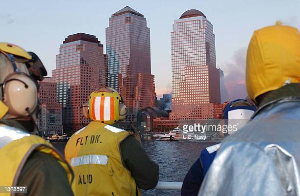 Sailors view smoke and building damage caused by the terrorist attack on the World Trade Center September 14 2001 from the deck of the Military...