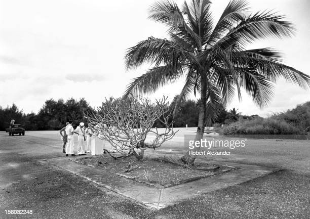 S sailors visit and take photos of the 'No 1 Bomb Loading Pit' on the island of Tinian in the Western Pacific Ocean From this pit the first atomic...