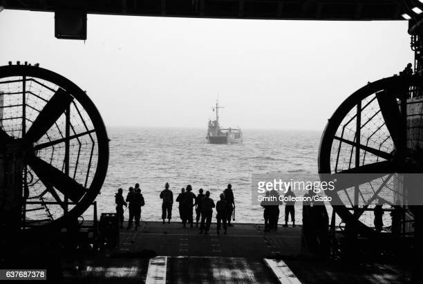 Sailors wait to perform a stern gate marriage with a utility landing craft in the well deck of the amphibious transport dock ship USS Green Bay...
