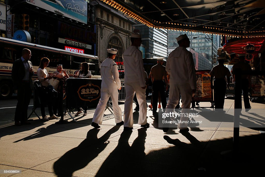 Sailors walk around Times Square during Fleet Week on May 25, 2016 in New York City. Nearly 4,500 Sailors, Marines and Coast Guardsmen will participate during Fleet Week New York (FWNY) this year. General public ship tours will be conducted daily throughout the week in Manhattan, Brooklyn and Staten Island.