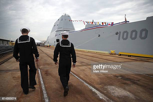 Sailors walk past the US Navy's new guided missile destroyer DDG 1000 USS Zumwalt on October 13 2016 in Baltimore Maryland The Zumwalt is the lead...