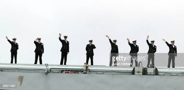 Sailors wave from the aircraft carrier HMS Ark Royal as she returns to her base 126 days after she set sail May 17 2003 in Portsmouth England The...