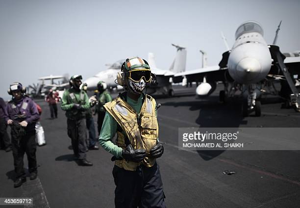 Sailors work on the flight deck of the US navy aircraft carrier USS George HW Bush on August 15 2014 in the Gulf The US aircraft carrier is...