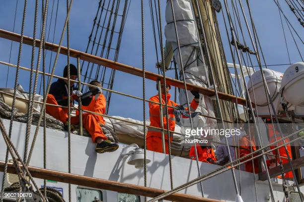 Sailors working at the STS Dar Mlodziezy sail training ship are seen in Gdynia Poland on 19 May 2018 Dar Mlodziezy first Polishbuilt oceangoing...