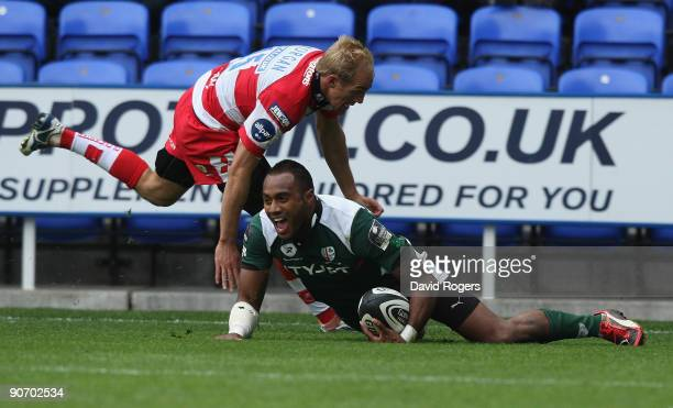 Sailosi Tagicakibau of London Irish dives over to score the fourth London Irish try despite the attention from Olly Morgan during the Guinness...