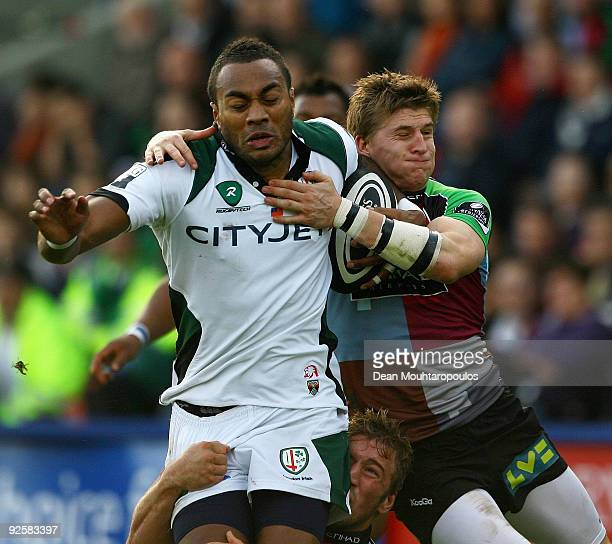 Sailosi Tagicakibau of London Irish is stopped by David Strettle of Harlequins during the Guinness Premiership match between Harlequins and London...