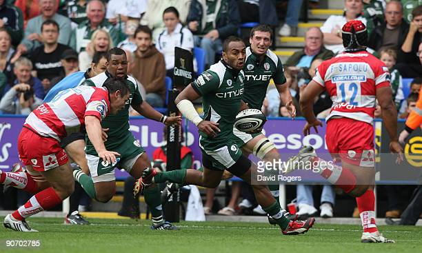 Sailosi Tagicakibau of London Irish races away to score the fourth London Irish try despite the attention from Olly Morgan during the Guinness...