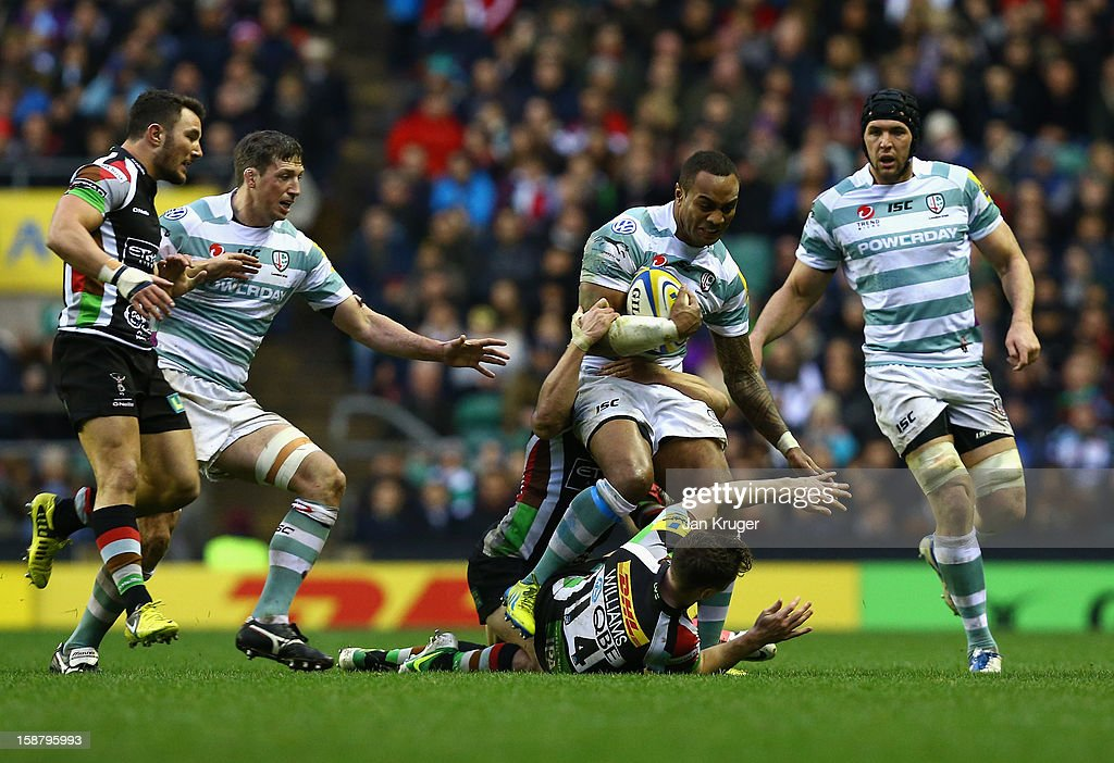 Sailosi Tagicakibau of London Irish tries to break past Tom Williams of Harlequins (on ground) during the Aviva Premiership match between Harlequins and London Irish at Twickenham Stadium on December 29, 2012 in London, England.