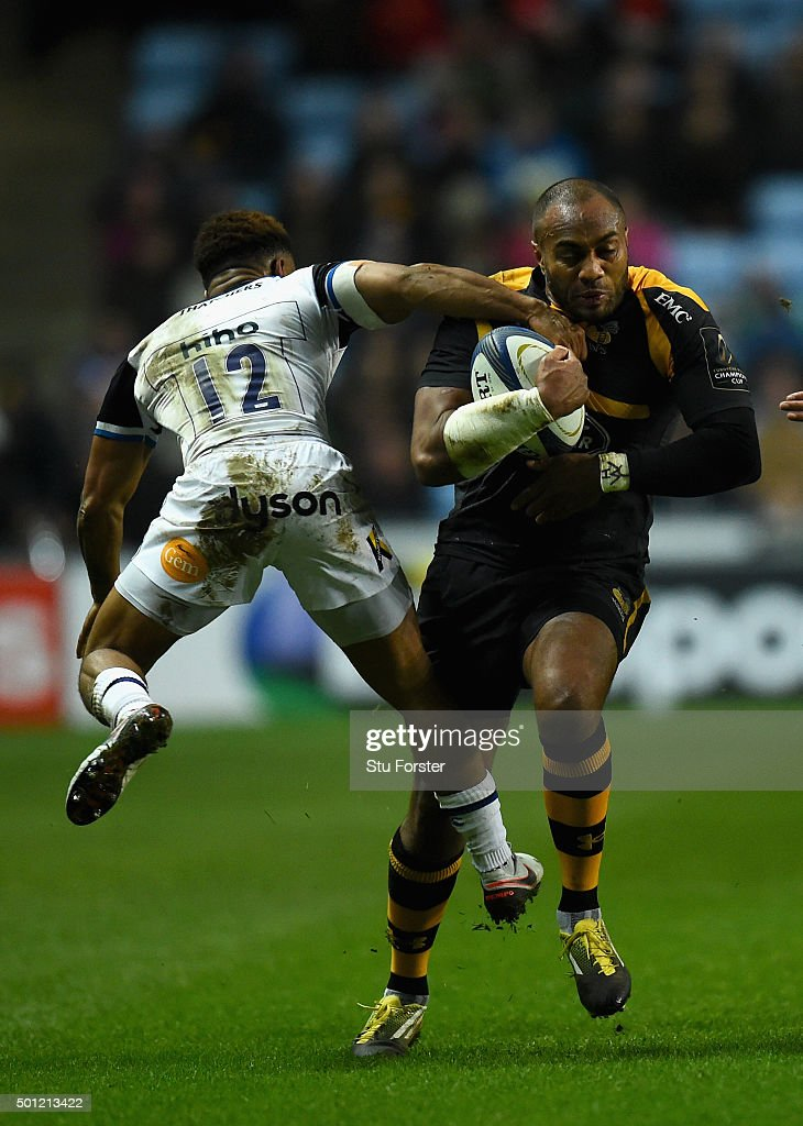 Sailosi Tagigakibau of Wasps is tackled by Kyle Eastmond of Bath during the European Rugby Champions Cup match between Wasps and Bath at Ricoh Arena on December 13, 2015 in Coventry, England.