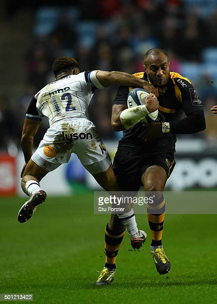 Sailosi Tagigakibau of Wasps is tackled by Kyle Eastmond of Bath during the European Rugby Champions Cup match between Wasps and Bath at Ricoh Arena...