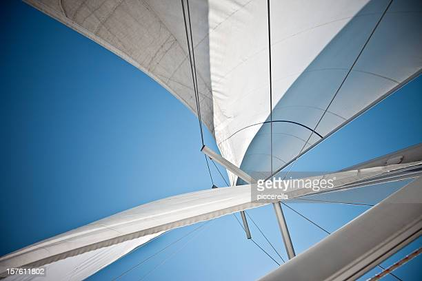 sails against a clear blue sky - sail boom stock pictures, royalty-free photos & images