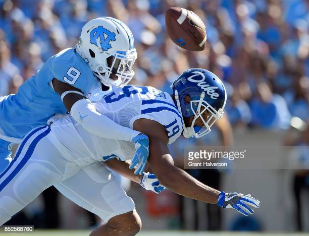 J Sails of the North Carolina Tar Heels defends a pass to Quay Chambers of the Duke Blue Devils during their game at Kenan Stadium on September 23...