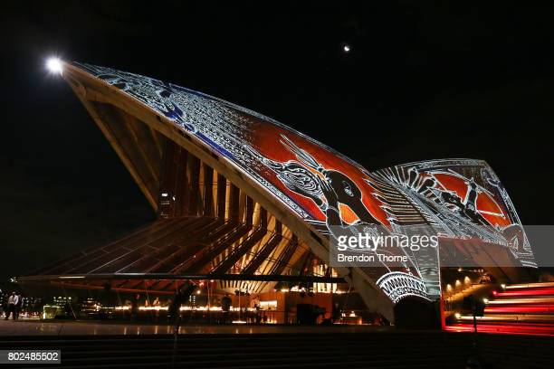 Sails of the Sydney Opera House are illuminated during the launch of Badu Gili 'Water Light' at Sydney Opera House on June 28 2017 in Sydney...