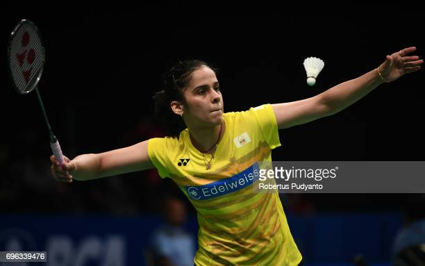 Saina Nehwal of India competes against Nitchaon Jindapol of Thailand during Womens Single Round 2 match of the BCA Indonesia Open 2017 at Plenary...