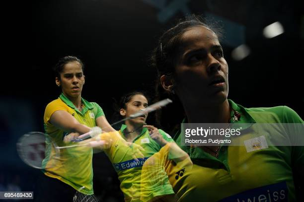 Saina Nehwal of India competes against Ratchanok Intanon of Thailand during Womens Single Round 1 match of the BCA Indonesia Open 2017 at Plenary...