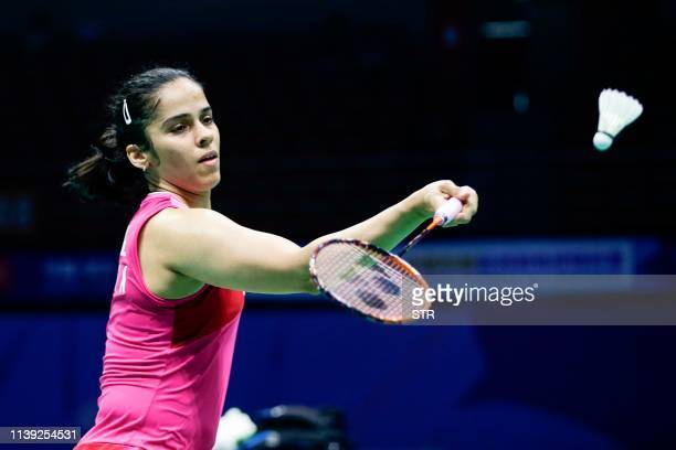Saina Nehwal of India hits a return against Kim Gaeun of South Korea during their women's singles second round match at the 2019 Badminton Asia...