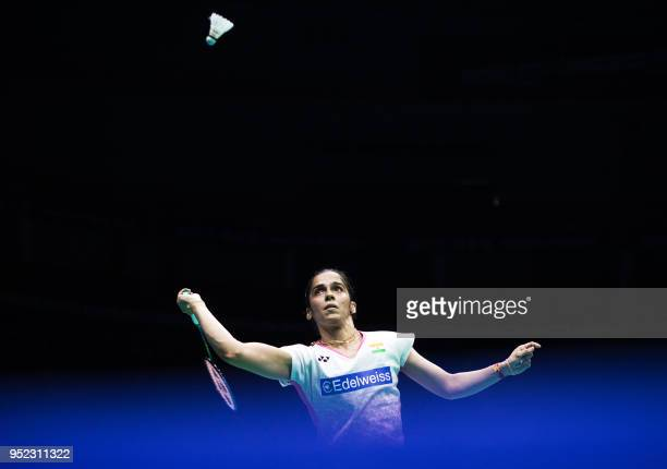 Saina Nehwal of India hits a return against Tai Tzuying of Taiwan during their women's singles semifinals match at the 2018 Badminton Asia...