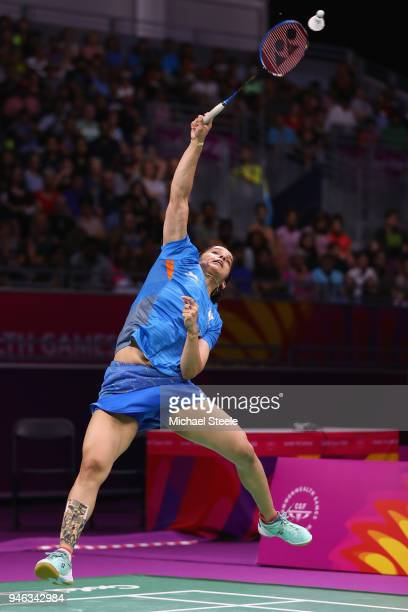 Saina Nehwal of India hits a return against Venkata Pusarla of India during the women's singles final during Badminton on day 11 of the Gold Coast...