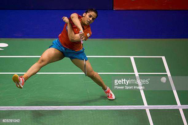 Saina Nehwal of India in action while playing against Porntip Buranaprasertsuk of Thailand during the 2016 Hong Kong Open Badminton Championships at...