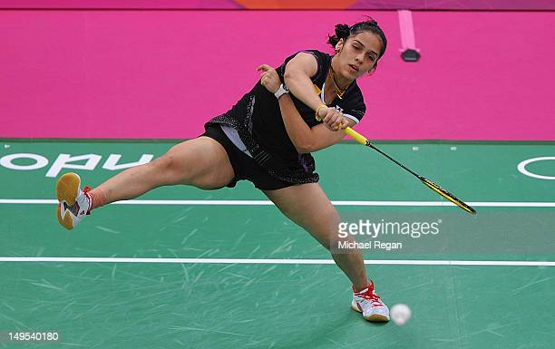 Saina Nehwal of India returns a shot against Lianne Tan of Belgium during their Women's Singles Badminton during Badminton match on Day 3 of the...